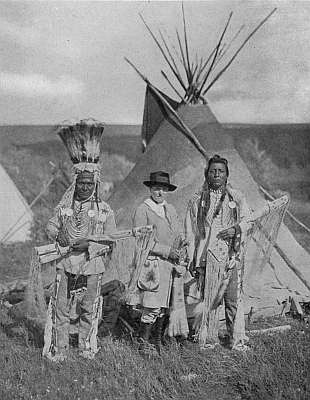 Pi-ta-mak-an, or Running Eagle (Mrs. Rinehart), with two other members of the Blackfoot Tribe. Image courtesy Tenting To-night