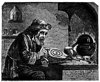 A man sits at a lab bench fanning a fire.