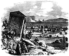 A city lies in the distance, surrounded by mountains. In the foreground there are ruins.