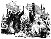 A woman is being burned on a pyre, while monks with crosses harangue her.