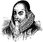 A bearded man wearing a skull-cap.