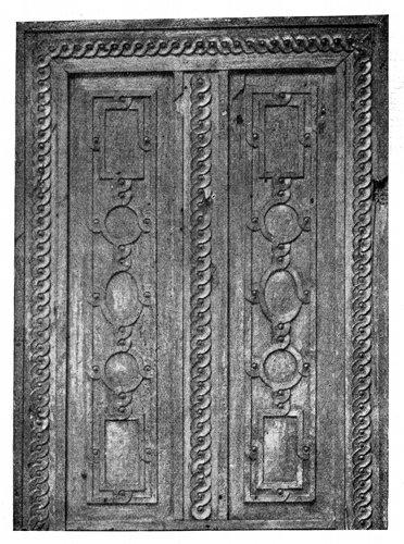 UPPER HALF OF CARVED WALNUT DOOR.