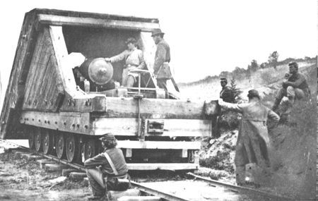 "Curious Federal soldiers inspect a Confederate armored gun, the earliest rail artillery on record. This ""land ram"", designed by Lt. John M. Brooke of the Confederate Navy, was first used at Savage Station, Virginia, in 1862."