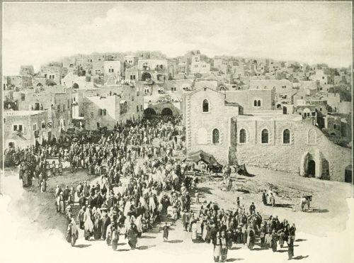 Crowd of people entering Bethlehem